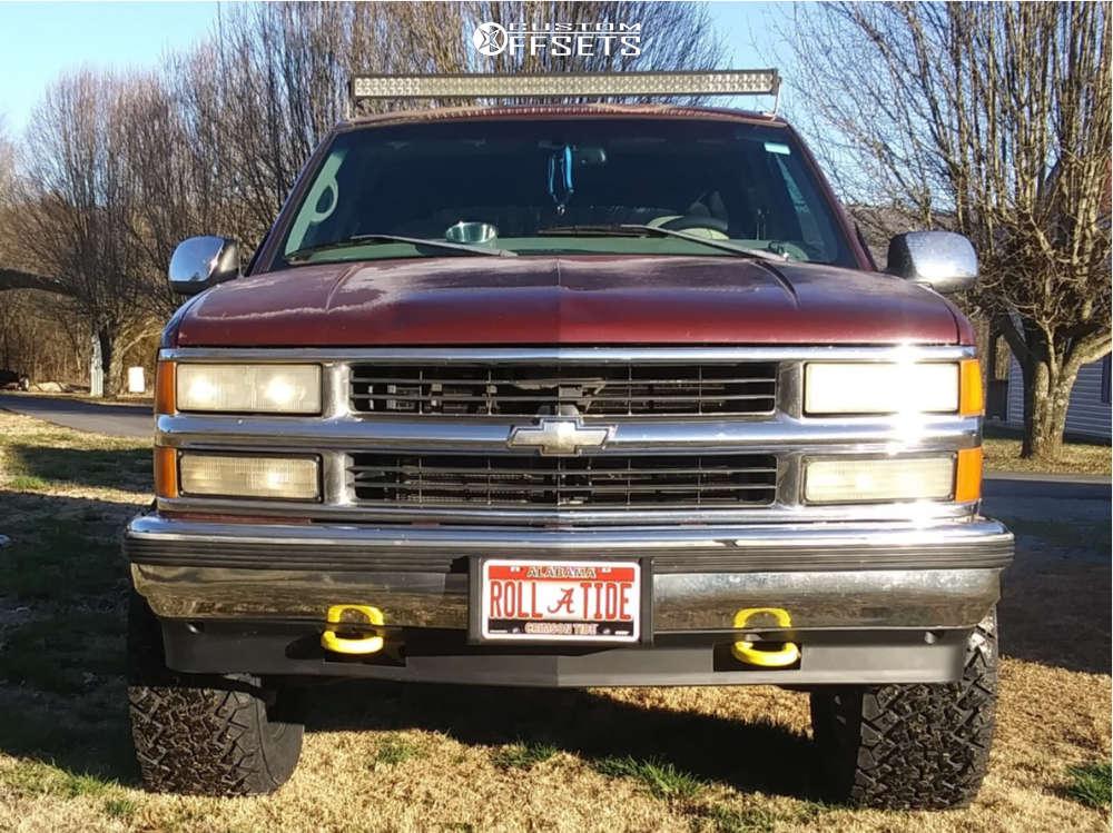 "1998 Chevrolet Tahoe Aggressive > 1"" outside fender on 18x10 -12 offset Vision Se7en and 33""x12.5"" Venom Terra Hunter X/t on Suspension Lift 3"" - Custom Offsets Gallery"