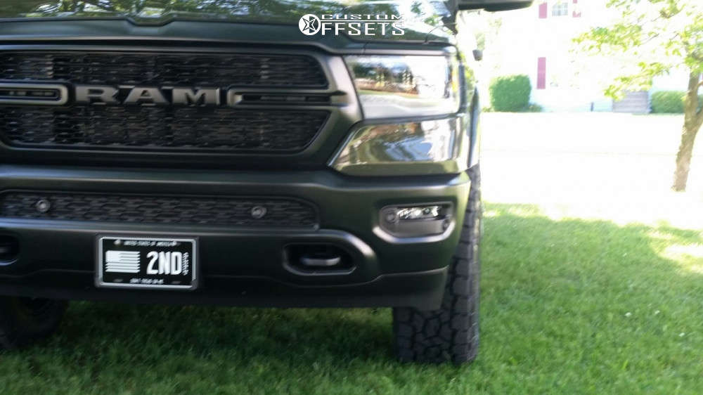 """2021 Ram 1500 Aggressive > 1"""" outside fender on 20x9.5 -12 offset Black Rhino Abrams and 295/60 Toyo Open Country A/t Iii on Suspension Lift 3.5"""" - Custom Offsets Gallery"""