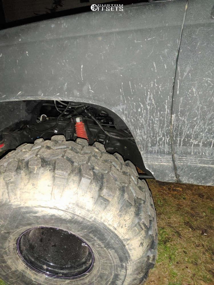 "1999 GMC K1500 Suburban Hella Stance >5"" on 15x15 101.6 offset Bart Super Trucker & 42""x15.5"" Super Swamper Tsl Bogger on Suspension Lift 9"" - Custom Offsets Gallery"