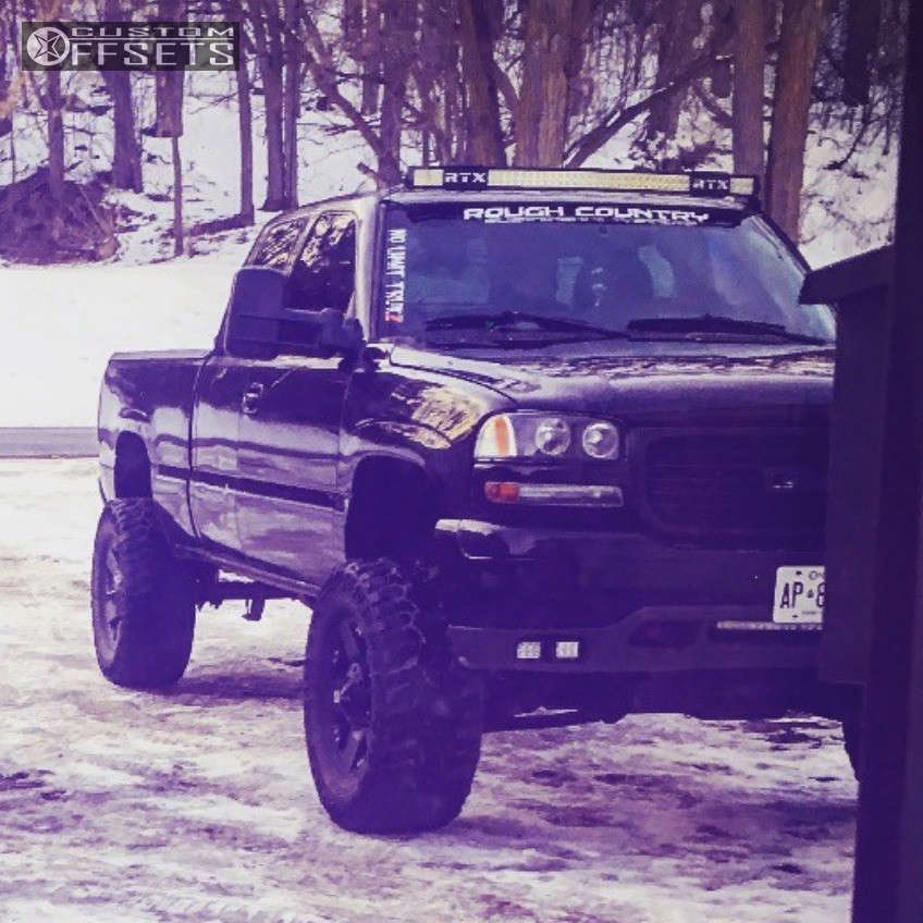 """2001 GMC Sierra 1500 Hella Stance >5"""" on 18x9 0 offset Xd Xd775 and 305/70 Cooper Discoverer Stt Pro on Suspension Lift 6"""" - Custom Offsets Gallery"""