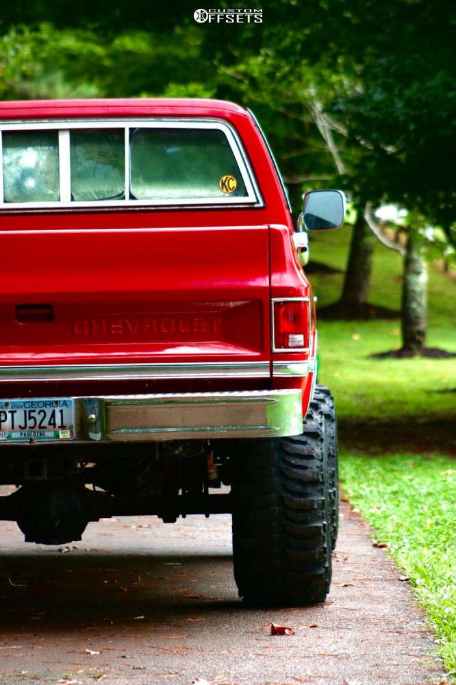 "1984 Chevrolet K10 Aggressive > 1"" outside fender on 15x12 -44 offset Steel Rally & 33""x14.5"" Super Swamper Bogger on Suspension Lift 4"" - Custom Offsets Gallery"