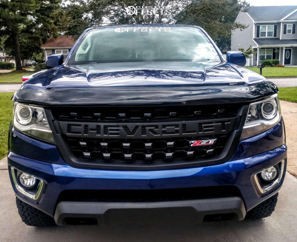 "2017 Chevrolet Colorado Aggressive > 1"" outside fender on 17x8 0 offset Moto Metal Mo970 & 31""x10.5"" BFGoodrich All Terrain T/a Ko2 on Stock Suspension - Custom Offsets Gallery"