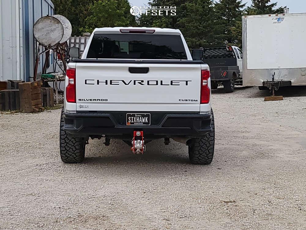 "2020 Chevrolet Silverado 2500 HD Aggressive > 1"" outside fender on 22x10 -25 offset Hostile Alpha & 35""x12.5"" Kenda Klever R/t on Stock Suspension - Custom Offsets Gallery"