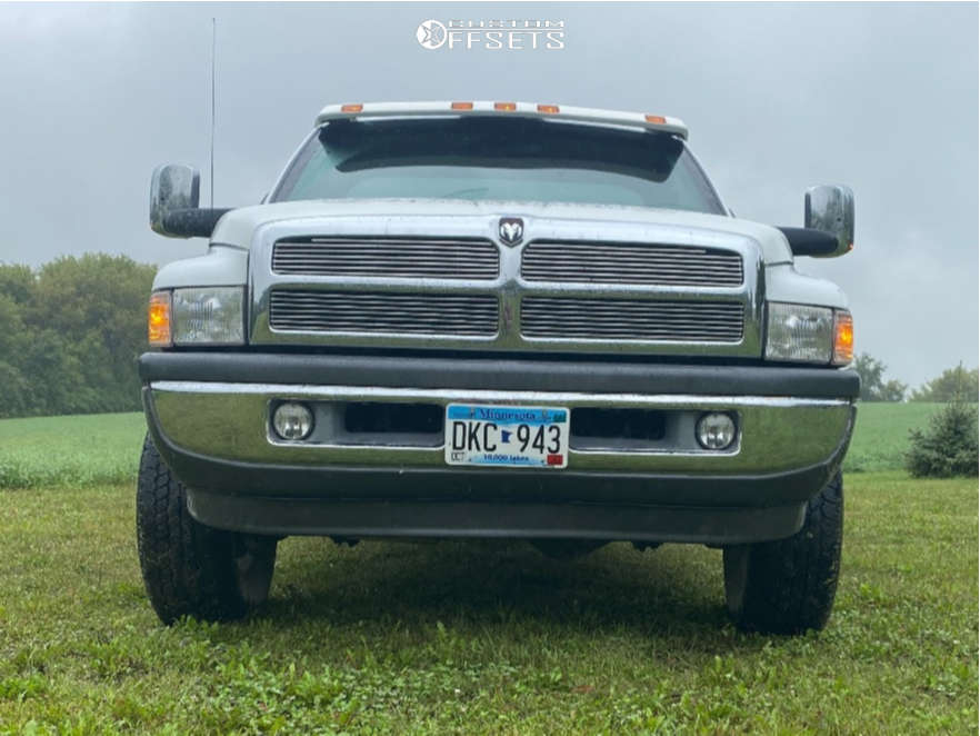 "2000 Dodge Ram 1500 Slightly Aggressive on 16x8 0 offset American Racing Ar23 & 31""x10.5"" Firestone Destination At2 on Stock Suspension - Custom Offsets Gallery"
