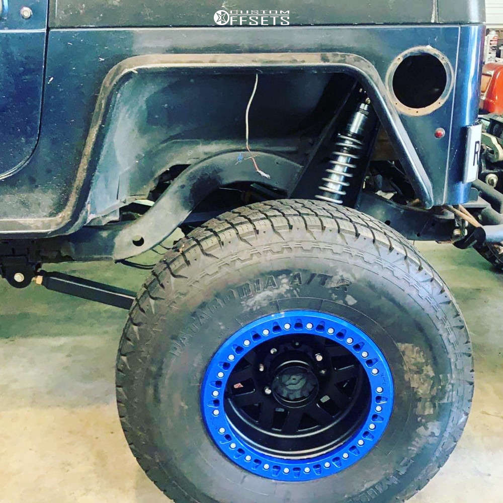 "2001 Jeep TJ Super Aggressive 3""-5"" on 17x9.5 -45 offset KMC Km229 Machete Crawl & 37""x13.5"" Milestar Patagonia At on Suspension Lift 7"" - Custom Offsets Gallery"