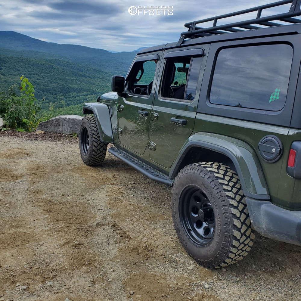 "2021 Jeep Wrangler Aggressive > 1"" outside fender on 17x9 -12 offset Black Rock Type 8 997b & 255/75 Firestone Destination Mt2 on Stock Suspension - Custom Offsets Gallery"