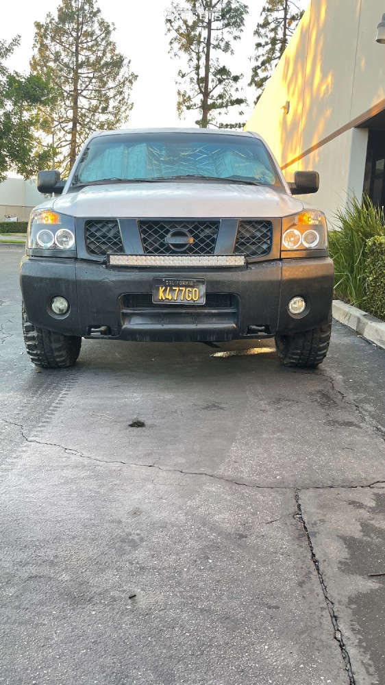 """2006 Nissan Titan Aggressive > 1"""" outside fender on 17x8 0 offset Moto Metal Mo970 & 33""""x12.5"""" Federal Couragia Mt on Stock Suspension - Custom Offsets Gallery"""