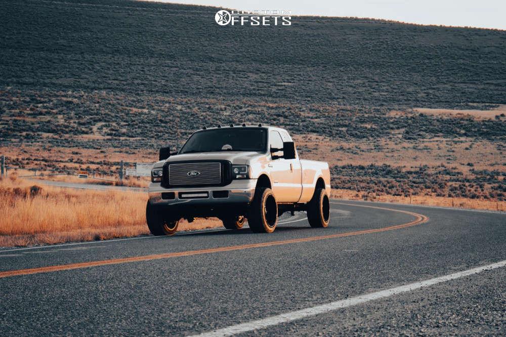 "2006 Ford F-250 Aggressive > 1"" outside fender on 22x12 -51 offset Vision Rocker & 33""x12.5"" Nitto Nt420v on Leveling Kit - Custom Offsets Gallery"