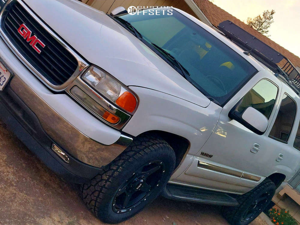 """2005 GMC Yukon Aggressive > 1"""" outside fender on 20x9 -12 offset Grid Gd04 & 305/50 Radar Renegade A/t 5 on Stock Suspension - Custom Offsets Gallery"""