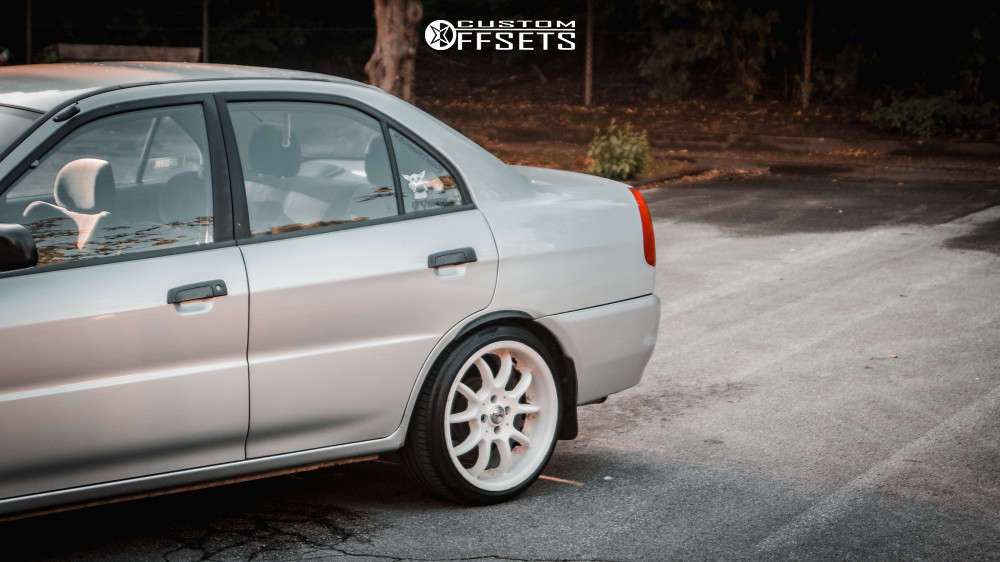 1997 Mitsubishi Lancer Nearly Flush on 17x8.5 35 offset Brock B6 RS & 205/40 Continental Contisportcontact 5 on Lowering Springs - Custom Offsets Gallery