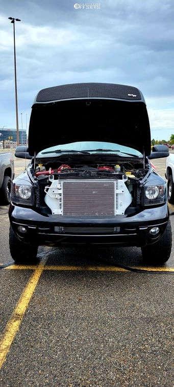 "2006 Dodge Ram 2500 Aggressive > 1"" outside fender on 20x10 -24 offset Anthem Off-Road Avenger & 33""x20"" Toyo Discoverer At3 on Leveling Kit - Custom Offsets Gallery"