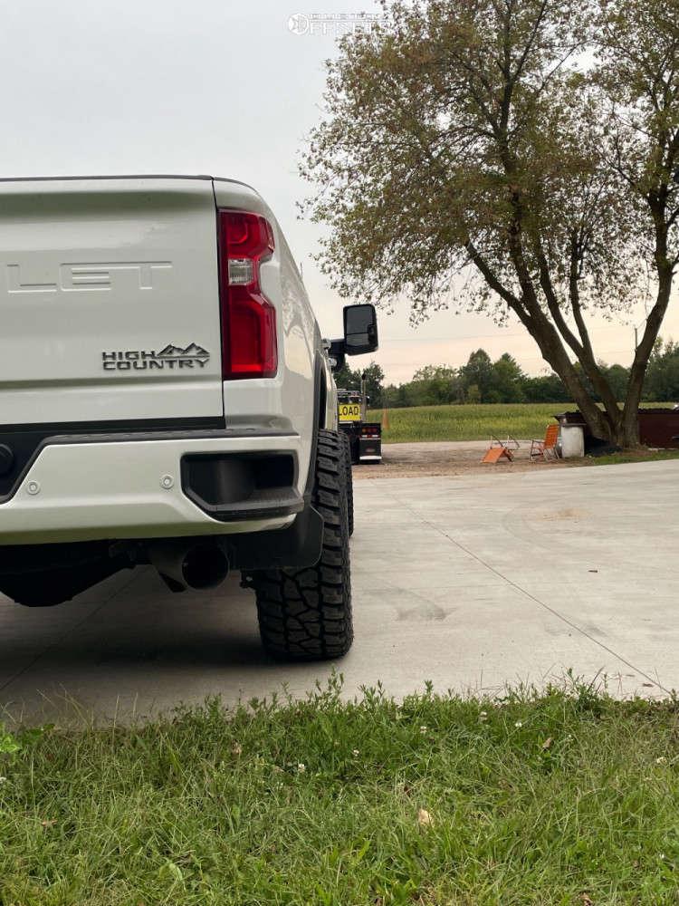 "2020 Chevrolet Silverado 2500 HD Aggressive > 1"" outside fender on 20x10 -19 offset Hostile H109 & 305/20 Mickey Thompson Atz P3 on Stock Suspension - Custom Offsets Gallery"