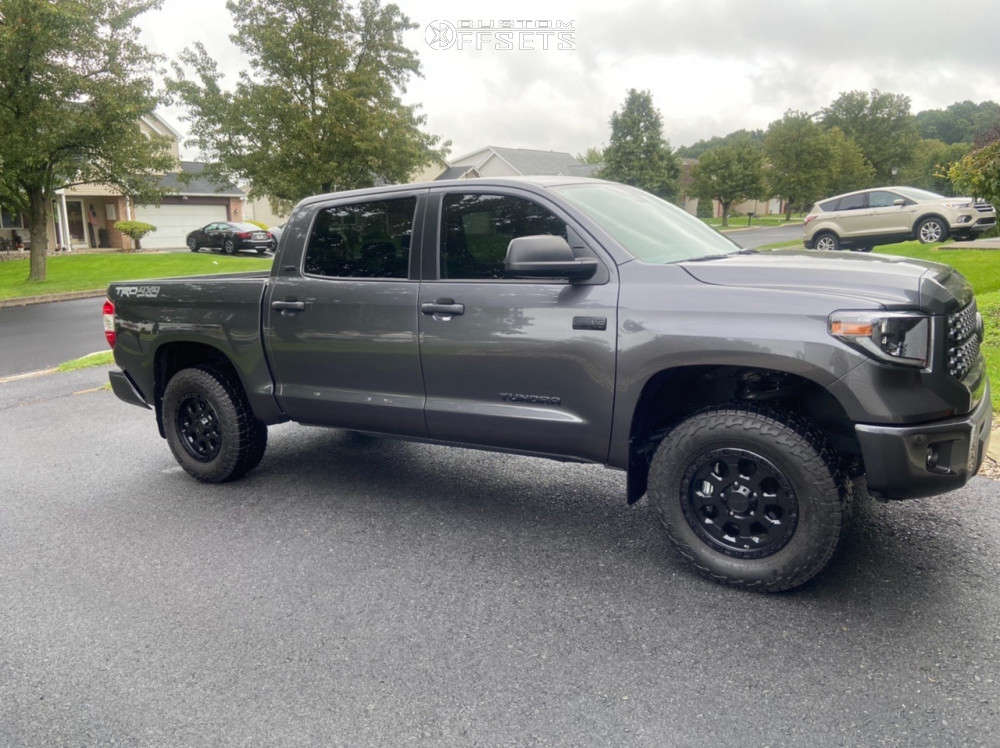 """2021 Toyota Tundra Aggressive > 1"""" outside fender on 18x9 40 offset American Racing Ar201 & 275/70 Falken Wildpeak At3w on Leveling Kit - Custom Offsets Gallery"""