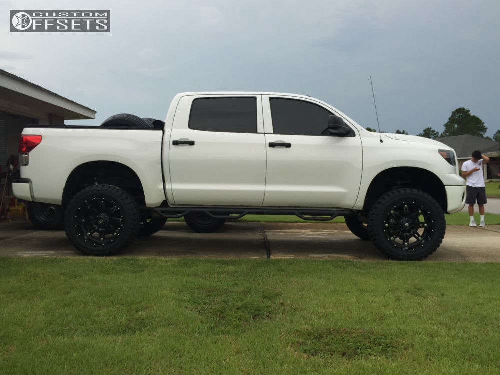 """2013 Toyota Tundra Super Aggressive 3""""-5"""" on 22x11 -24 offset Fuel Hostage and 35""""x12.5"""" Toyo Tires Open Country M/T on Suspension Lift 7"""" - Custom Offsets Gallery"""