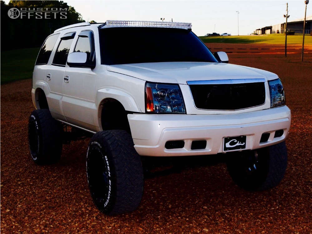 """2003 Cadillac Escalade Hella Stance >5"""" on 22x14 -70 offset Fuel Cleaver and 37""""x13.5"""" Toyo Tires Open Country M/T on Lifted >12"""" - Custom Offsets Gallery"""