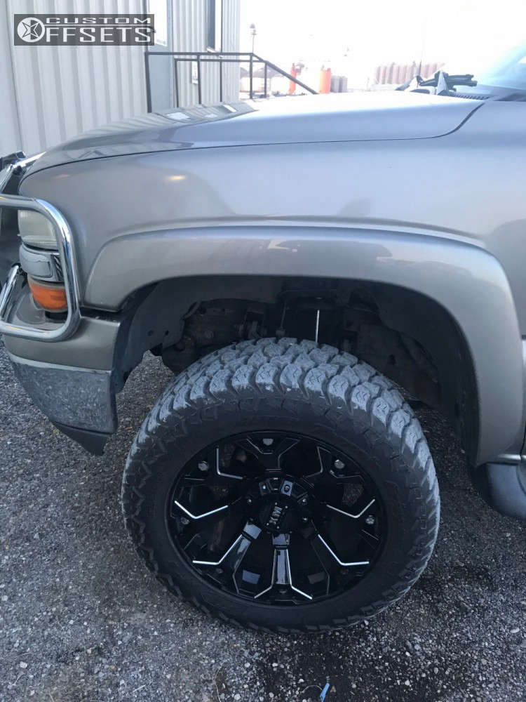 """2003 Chevrolet Suburban Slightly Aggressive on 20x10 -12 offset Xtreme Mudder Xm-318 and 285/55 Amp Terrain Gripper At G on Suspension Lift 6"""" - Custom Offsets Gallery"""