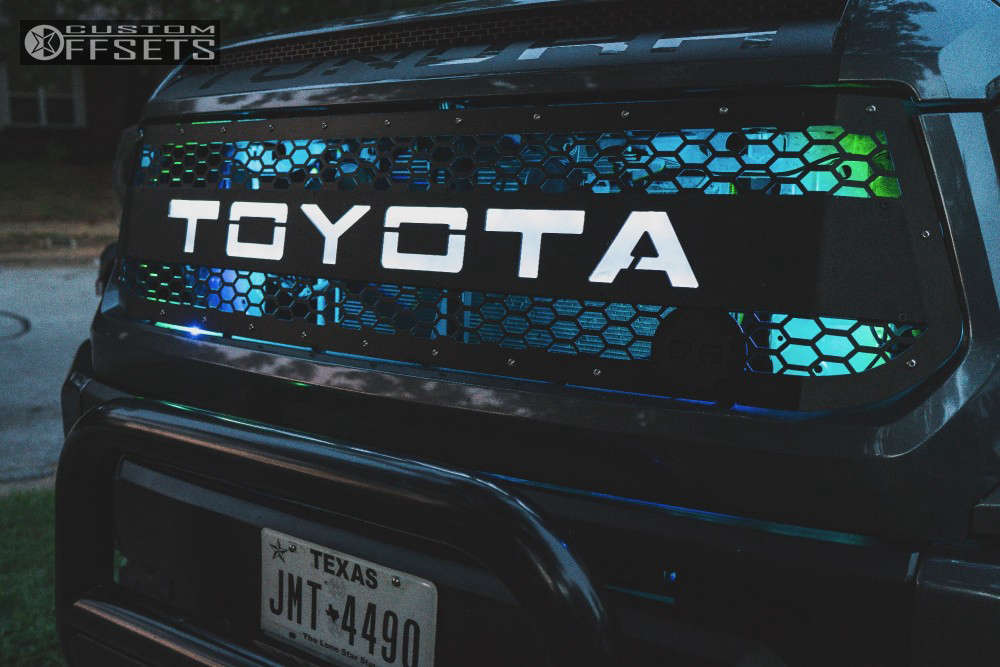 """2016 Toyota Tundra Aggressive > 1"""" outside fender on 22x12 -44 offset Fuel Assault and 40""""x15.5"""" Nitto Mud Grappler on Lifted >12"""" - Custom Offsets Gallery"""
