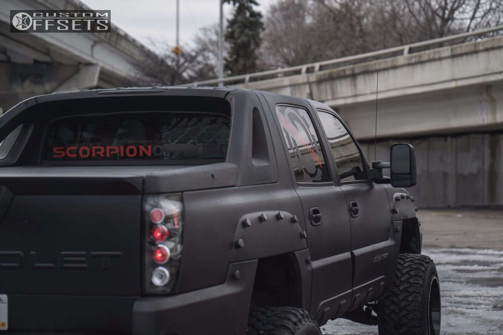 """2003 Chevrolet Avalanche Hella Stance >5"""" on 20x14 -76 offset Scorpion Sc17 and 35""""x13.5"""" Free Passer Ct404 on Suspension Lift 6"""" - Custom Offsets Gallery"""
