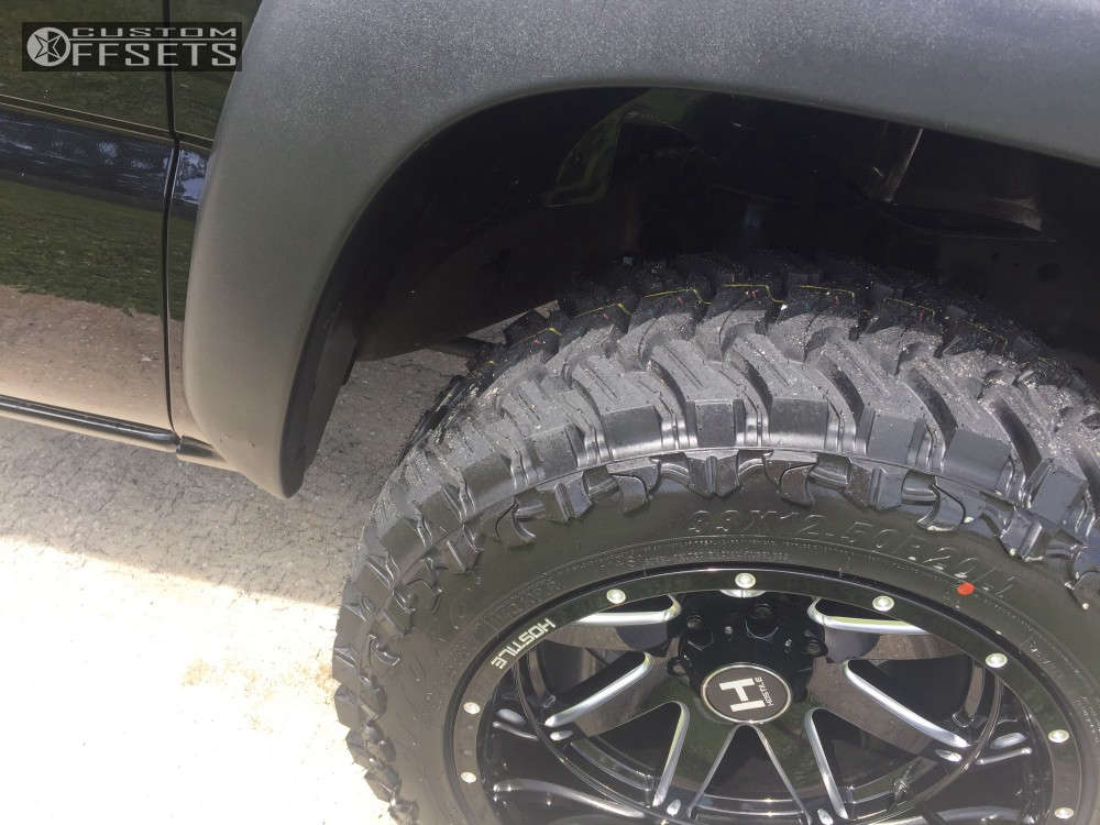 """2006 Chevrolet Suburban Aggressive > 1"""" outside fender on 20x12 -44 offset Hostile Alpha and 33""""x12.5"""" Atturo Trail Blade Mt on Leveling Kit - Custom Offsets Gallery"""