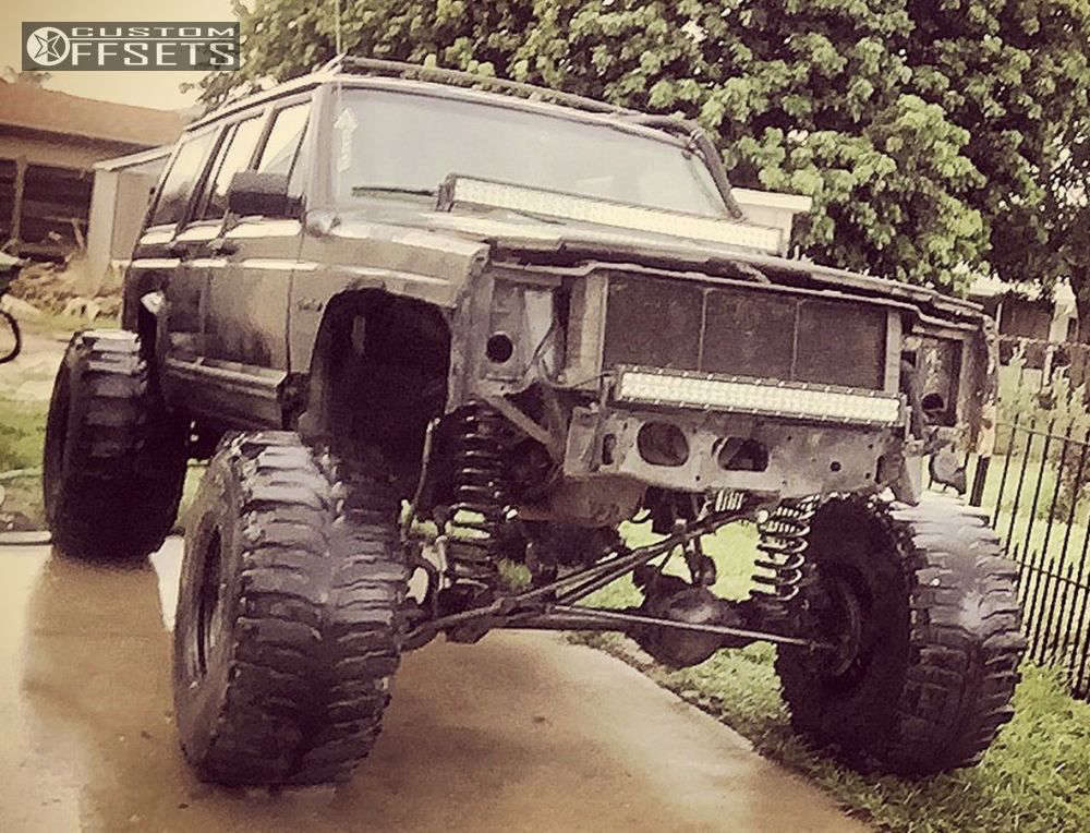 """1994 Jeep Cherokee Hella Stance >5"""" on 15x14 -76 offset Bart Super Trucker and 35""""x14.5"""" Interco Bogger on Lifted >9"""" - Custom Offsets Gallery"""