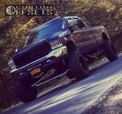 """2001 Ford F-350 Hella Stance >5"""" on 20x12 -44 offset Moto Metal Mo962 and 37""""x13.5"""" Atturo Trail Blade Mt on Suspension Lift 10"""" - Custom Offsets Gallery"""