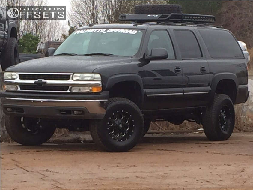 """2004 Chevrolet Suburban Slightly Aggressive on 17x9 -12 offset Fuel Revolver and 305/70 Nitto Terra Grappler G2 on Suspension Lift 6.5"""" - Custom Offsets Gallery"""