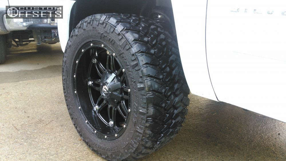 """2010 Chevrolet Silverado 1500 Aggressive > 1"""" outside fender on 20x10 -24 offset Fuel Hostage and 305/55 Nitto Trail Grappler on Leveling Kit - Custom Offsets Gallery"""