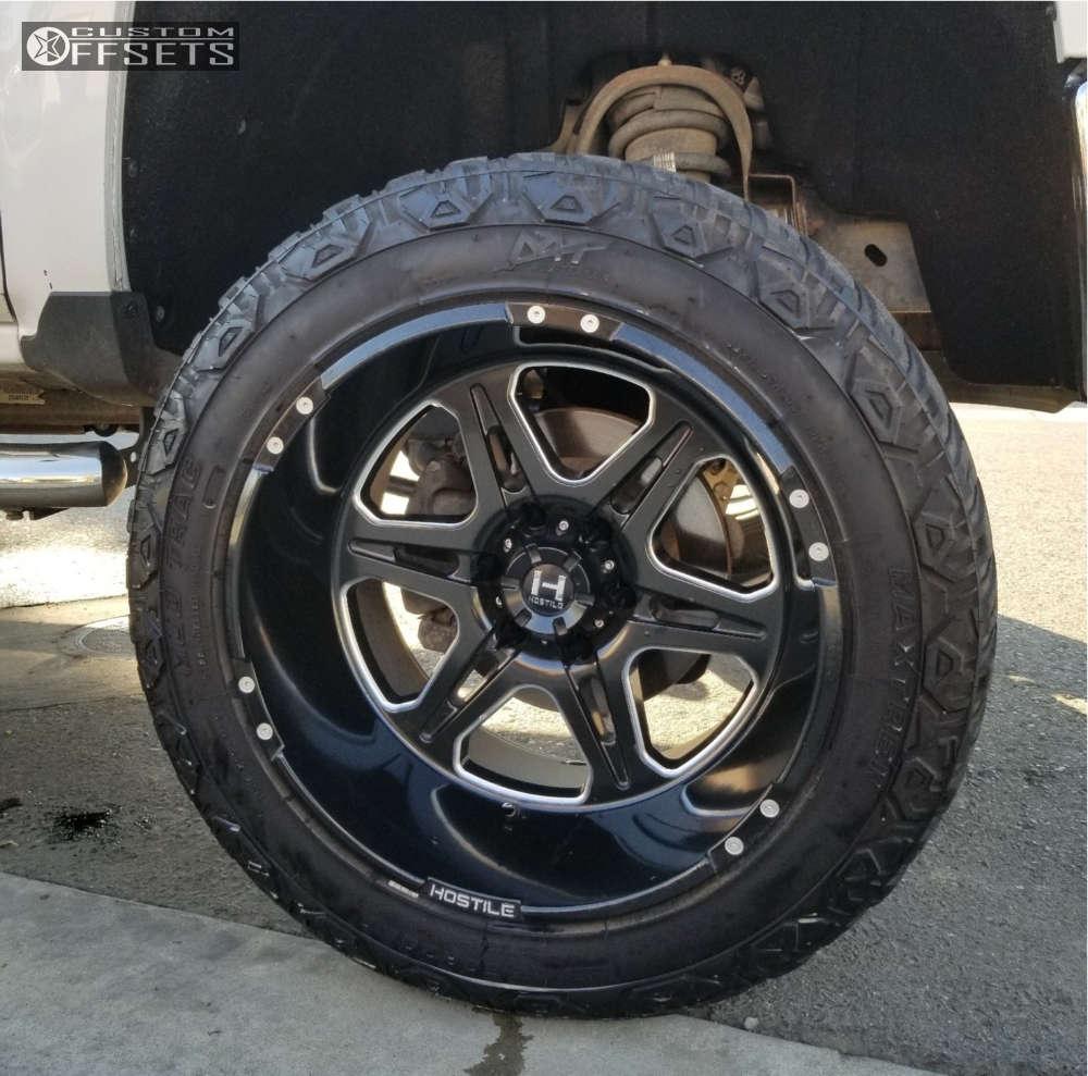 "2014 Chevrolet Silverado 1500 Super Aggressive 3""-5"" on 20x12 -44 offset Hostile Havoc & 33""x12.5"" Maxtrek Mud Trac M/t on Suspension Lift 6"" - Custom Offsets Gallery"