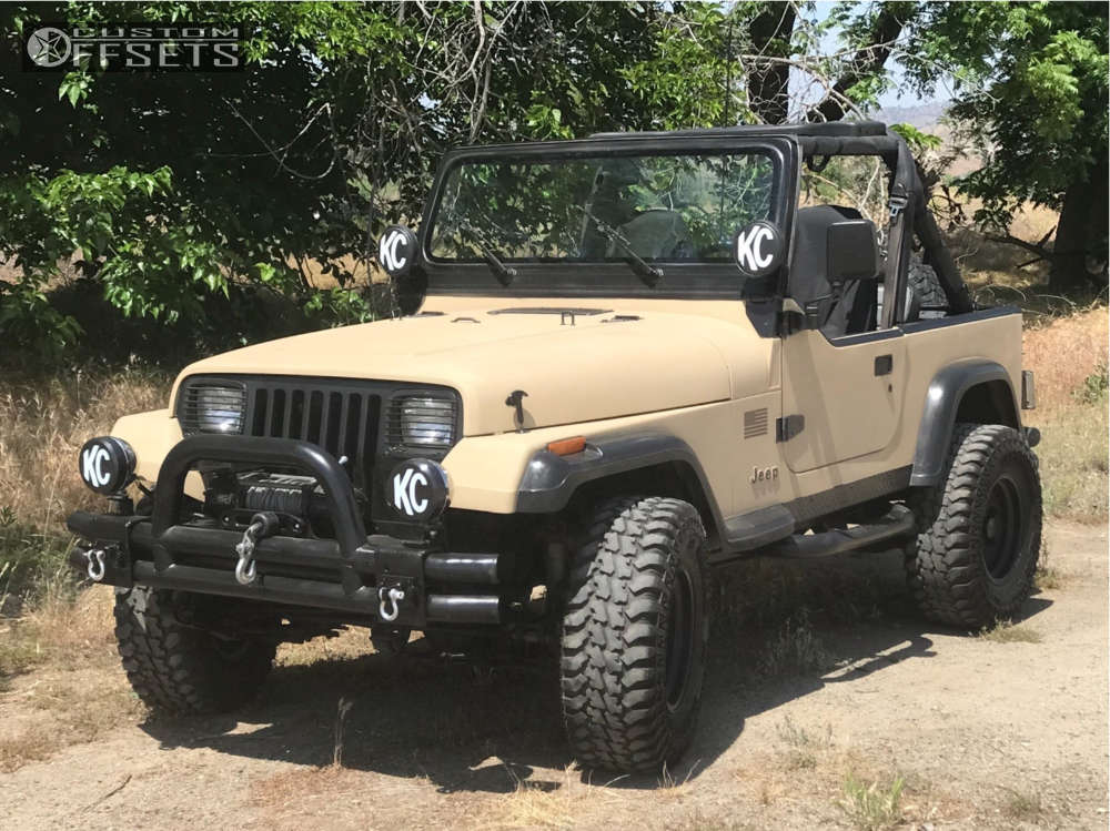 """1991 Jeep Wrangler Aggressive > 1"""" outside fender on 15x8 0 offset Eagle Alloy Series 058 and 31""""x10.5"""" Radar Renegade At-5 on Stock Suspension - Custom Offsets Gallery"""