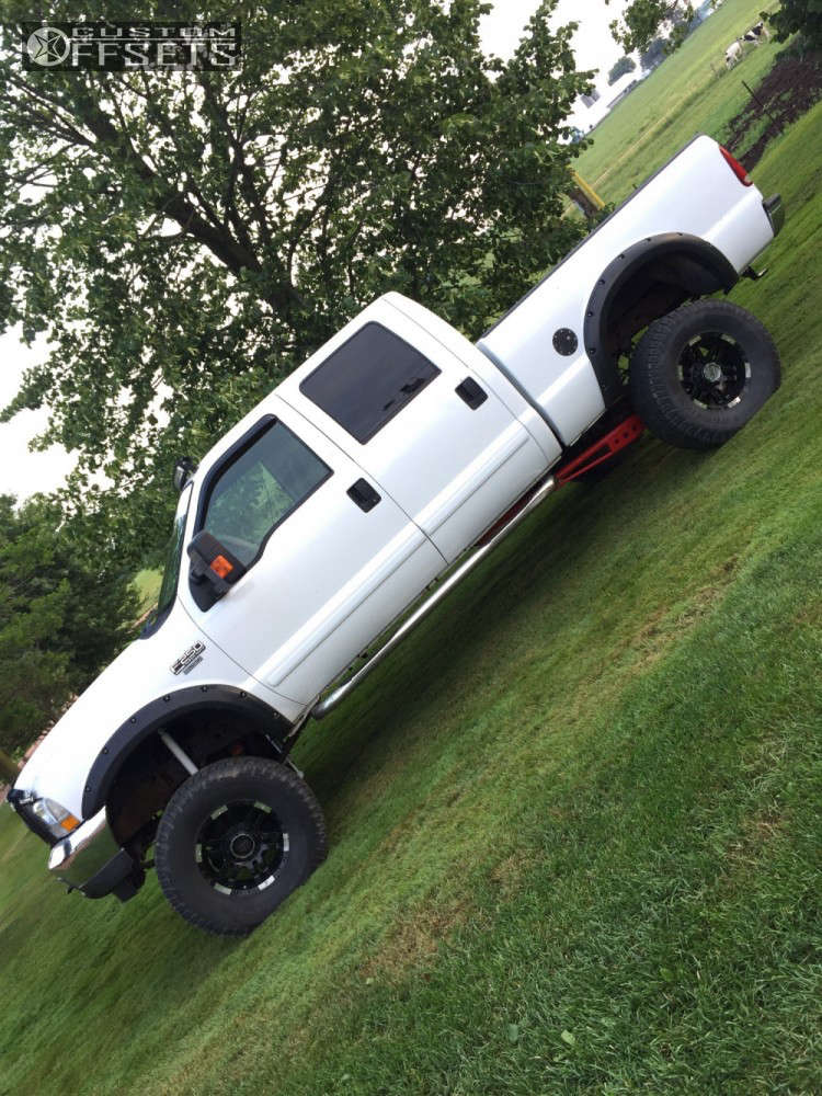 """2002 Ford F-250 Super Duty Super Aggressive 3""""-5"""" on 18x9 -12 offset Moto Metal Mo951 and 325/65 Toyo Tires Open Country A/T II on Suspension Lift 8"""" - Custom Offsets Gallery"""