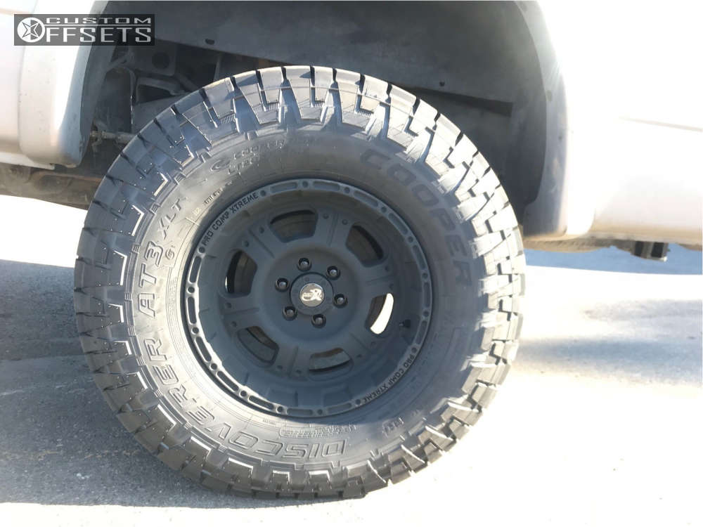 """2000 Dodge Dakota Aggressive > 1"""" outside fender on 16x8 -12 offset Pro Comp Series 89 and 285/75 Cooper Discoverer At3 on Suspension Lift 3"""" - Custom Offsets Gallery"""
