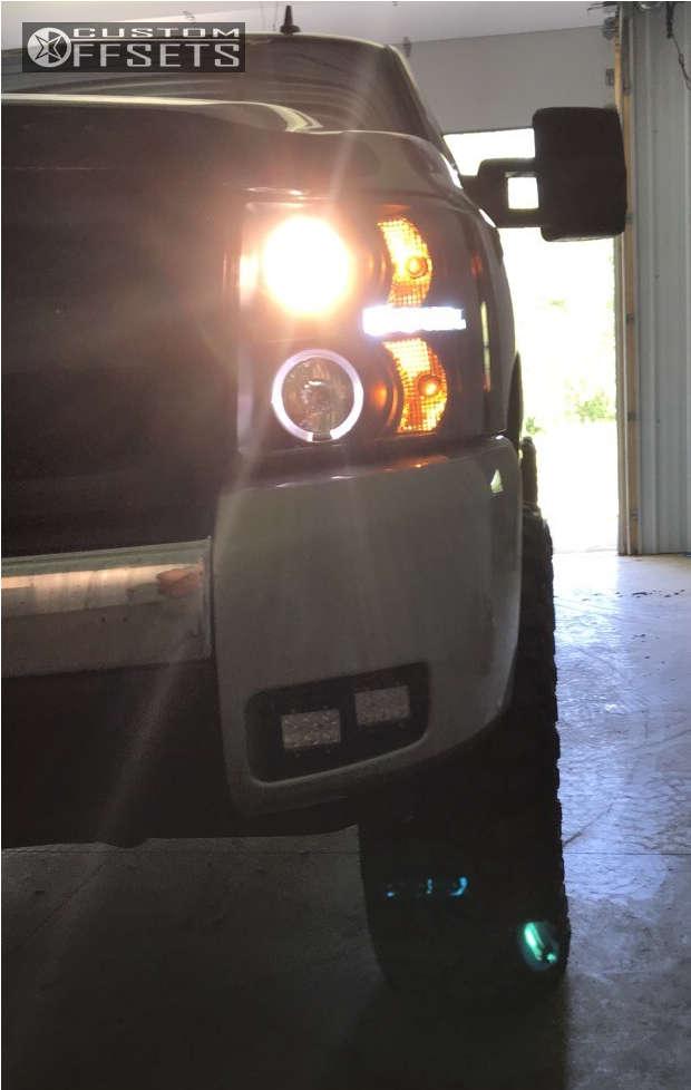 "2010 Chevrolet Silverado 1500 Aggressive > 1"" outside fender on 20x9 18 offset Worx Havoc & 35""x12.5"" Cooper Discoverer Stt Pro on Suspension Lift 6"" - Custom Offsets Gallery"