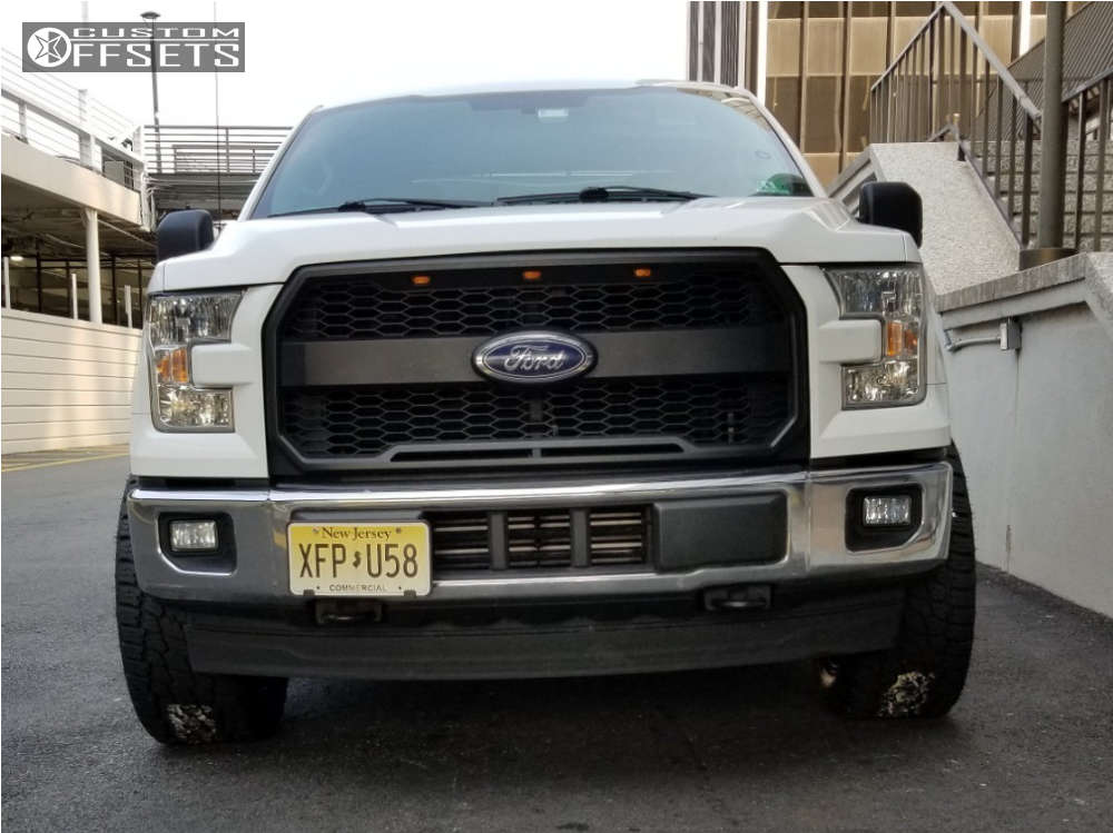 """2017 Ford F-150 Aggressive > 1"""" outside fender on 20x10 -18 offset Fuel Contra and 305/50 Nitto Terra Grappler G2 on Leveling Kit - Custom Offsets Gallery"""