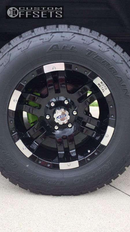 "2004 Chevrolet Silverado 1500 Aggressive > 1"" outside fender on 18x9 -12 offset Moto Metal MO951 & 285/65 Nitto Terra Grappler G2 on Leveling Kit - Custom Offsets Gallery"