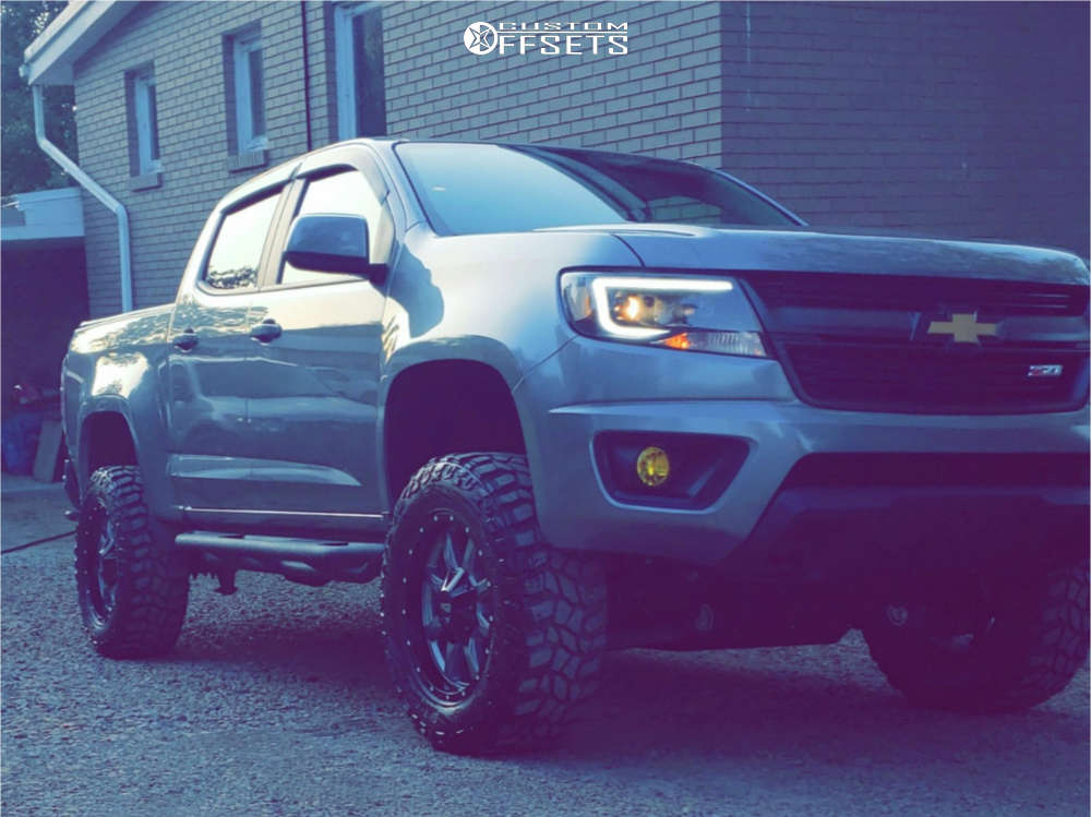"""2018 Chevrolet Colorado Aggressive > 1"""" outside fender on 18x9 18 offset Moto Metal Mo970 & 275/65 Cooper Discoverer Stt Pro on Suspension Lift 4"""" - Custom Offsets Gallery"""