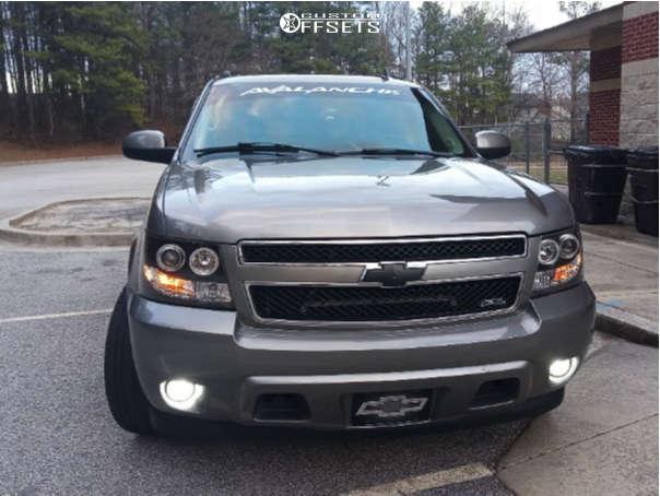 "2007 Chevrolet Avalanche Aggressive > 1"" outside fender on 20x9 -10 offset Ultra Predator & 275/55 Bridgestone Dueler H/l Alenza Plus on Stock - Custom Offsets Gallery"