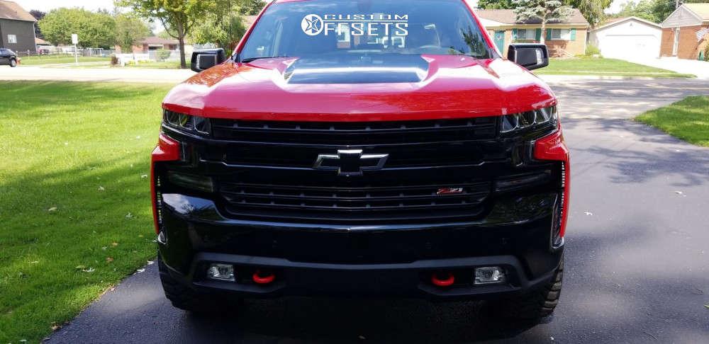 "2019 Chevrolet Silverado 1500 Aggressive > 1"" outside fender on 20x9 0 offset Moto Metal Mo969 & 305/55 Mickey Thompson Baja Mtz P3 on Stock Suspension - Custom Offsets Gallery"