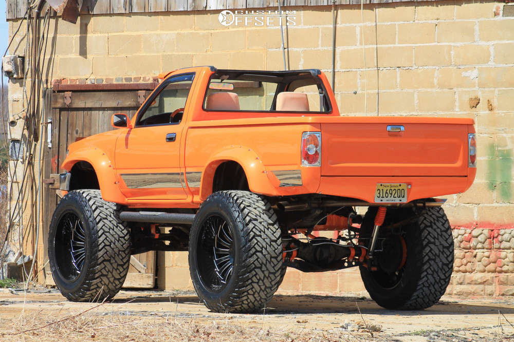 """1989 Toyota Pickup Aggressive > 1"""" outside fender on 24x14 -81 offset ARKON OFF-ROAD Alexander and 40""""x15.5"""" Fuel Mud Gripper on Suspension Lift 4"""" - Custom Offsets Gallery"""