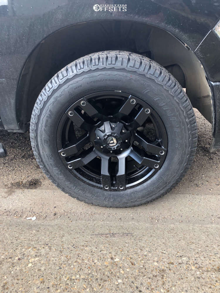 """2011 Ram 1500 Aggressive > 1"""" outside fender on 20x10 -24 offset Fuel Pump and 305/55 Cooper Discoverer At3 on Leveling Kit - Custom Offsets Gallery"""
