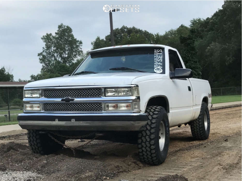 "1997 Chevrolet K1500 Aggressive > 1"" outside fender on 15x8 0 offset Pro Comp series 69 & 33""x12.5"" Nankang Mudstars on Stock Suspension - Custom Offsets Gallery"