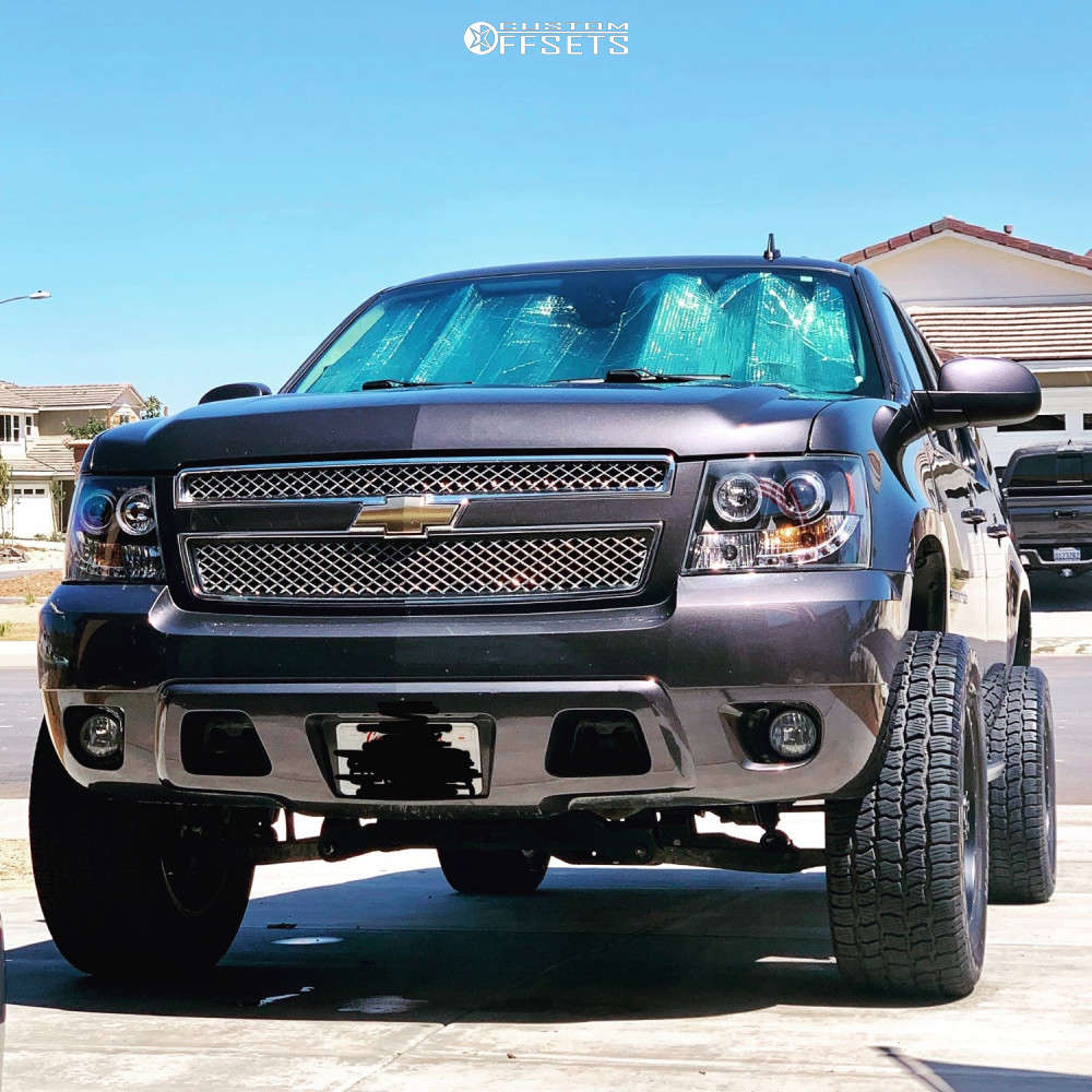 """2010 Chevrolet Suburban Super Aggressive 3""""-5"""" on 20x9 0 offset Pro Comp Series 48 & 305/55 Cooper Discoverer X/t 4 on Suspension Lift 5"""" - Custom Offsets Gallery"""