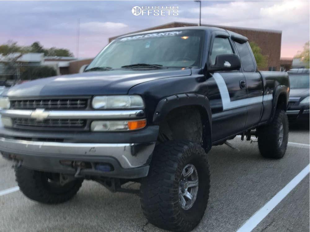 "2002 Chevrolet Silverado 1500 Aggressive > 1"" outside fender on 16x8 0 offset American Racing ATX Predator and 315/75 Mickey Thompson Baja Mtz P3 on Suspension Lift 6"" - Custom Offsets Gallery"