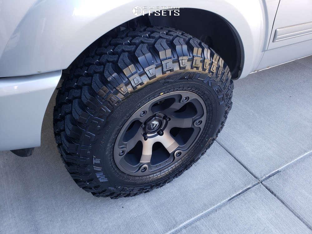 "2005 Dodge Durango Aggressive > 1"" outside fender on 17x9 -12 offset Fuel Beast and 285/70 Falken Wildpeak Mt on Suspension Lift 2.5"" - Custom Offsets Gallery"