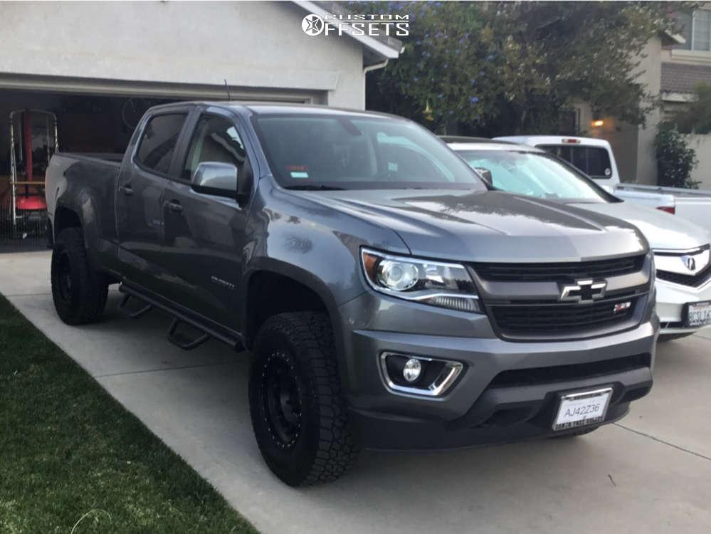 "2019 Chevrolet Colorado Aggressive > 1"" outside fender on 17x8.5 0 offset Method Mr315 & 265/70 Falken Wildpeak At3w on Leveling Kit - Custom Offsets Gallery"