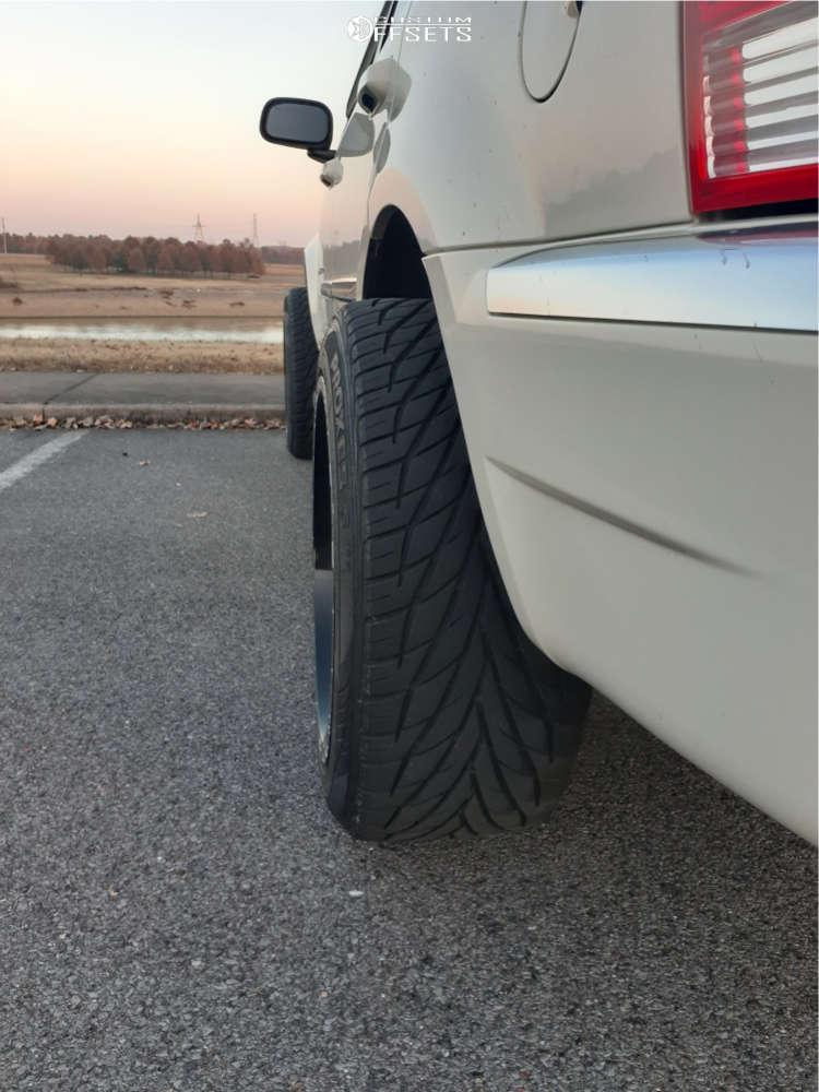 "2007 Chrysler Aspen Hella Stance >5"" on 22x12 -44 offset TIS 544bm & 305/45 Toyo Tires Proxes S/t on Stock Suspension - Custom Offsets Gallery"