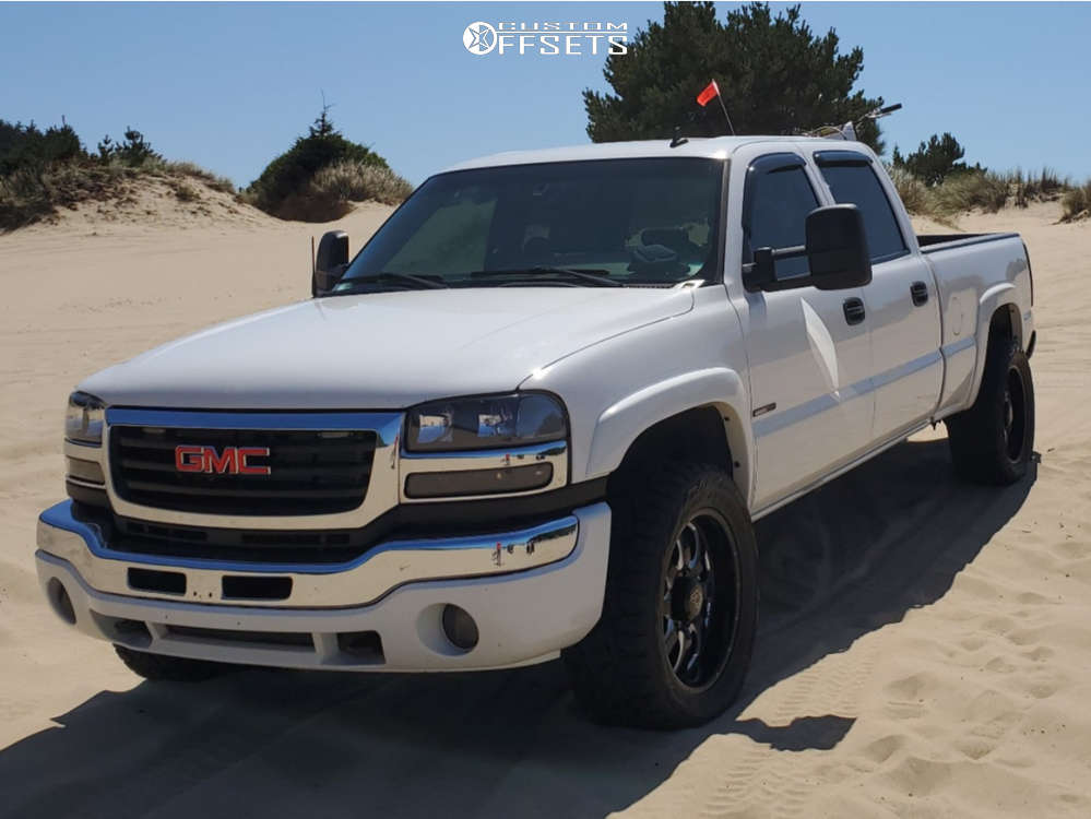 """2006 GMC Sierra 2500 HD Classic Aggressive > 1"""" outside fender on 20x9 0 offset American Eagle series 014 & 33""""x12.5"""" Toyo Tires Open Country R/T on Level 2"""" Drop Rear - Custom Offsets Gallery"""