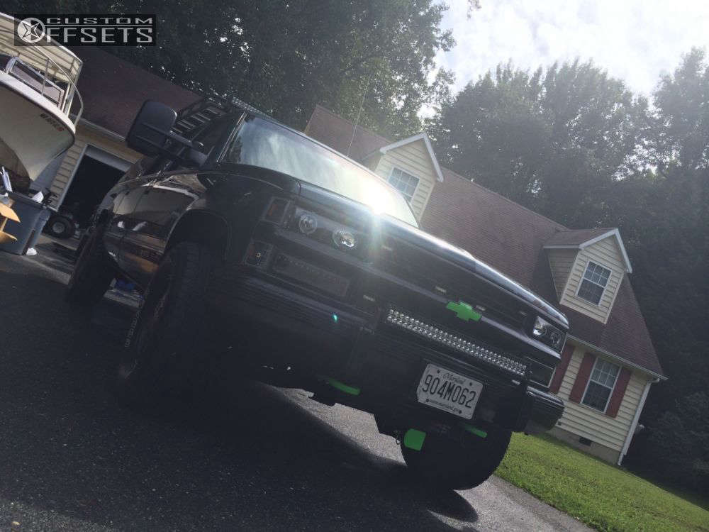 """1994 Chevrolet K1500 Suburban Aggressive > 1"""" outside fender on 17x7 31 offset Spaced out Stockers Spaced out stockers and 30""""x10.5"""" Cooper A/T3 on Leveling Kit - Custom Offsets Gallery"""