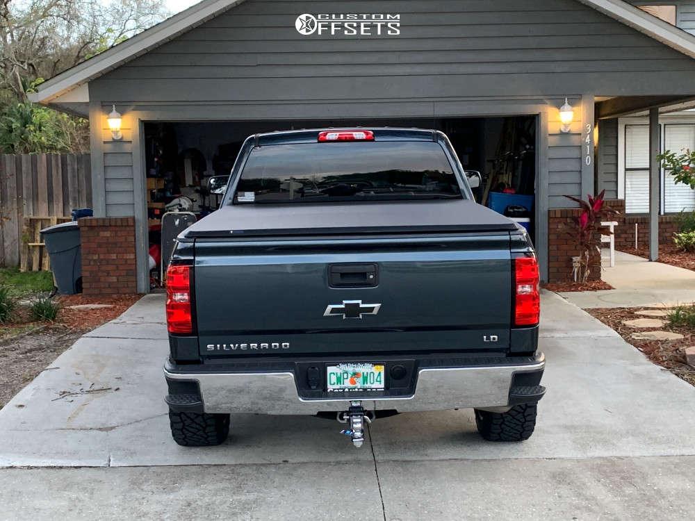 "2019 Chevrolet Silverado 1500 LD Aggressive > 1"" outside fender on 20x10 -25 offset Motiv Offroad Magnus & 275/55 Nitto Ridge Grappler on Leveling Kit - Custom Offsets Gallery"