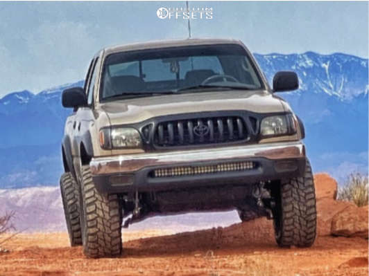 "2003 Toyota Tacoma Aggressive > 1"" outside fender on 15x8 -24 offset Raceline Defender and 32""x11.5"" Mastercraft Courser Mxt on Leveling Kit - Custom Offsets Gallery"