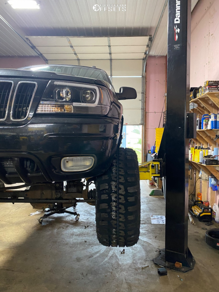 "2001 Jeep Grand Cherokee Super Aggressive 3""-5"" on 20x12 -51 offset Vision Spyder and 33""x12.5"" Federal Couragia Mt on Suspension Lift 4"" - Custom Offsets Gallery"
